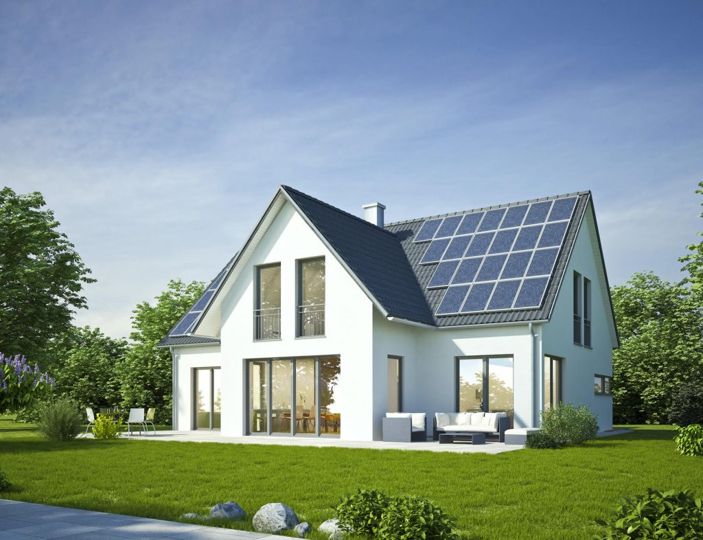 Modern white house with solar panels